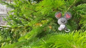 Christmas felt decoration on a spruce branch. Handmade bauble figurines a butterfly. Holiday background with a copy space. Suitable for greeting cards, banners stock video footage