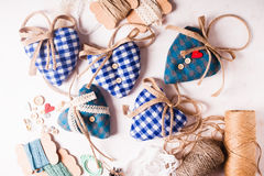 Christmas felt hearts. Christmas or Valentine vintage decor - bolue gingham hearts sewing preparations Stock Photography