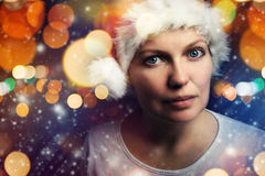 Christmas female beauty portrait with snowflakes. Christmas female with Santa Claus hat beauty portrait with snowflakes and bokeh light effect Stock Photography