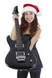 Christmas female guitarist showing a black electric guitar Royalty Free Stock Photography