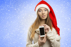 Christmas female showing iphone stock images