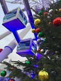 Christmas Ferris wheel. Christmas tree in the background of the Ferris wheel stock photography