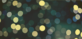 Christmas festive abstract holidays background with bokeh defocused lights and stars Royalty Free Stock Image