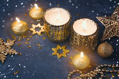 Christmas festive background with candles and golden decorations Stock Photo