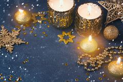 Christmas festive background with candles and golden decorations Stock Photography