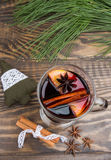 Christmas festive background with mulled wine, orange and fir branches. Christmas drink. Royalty Free Stock Images