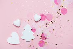 Christmas festive banner background: white christmas tree and confetti with sparcling glitter and stars. royalty free stock image