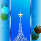 Christmas festive blue background with tree and baubles. Christmas Festive Blue Background with Metallic Panel Abstract Tree star and Glass Baubles Stock Photo