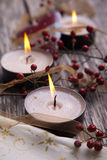 Christmas festive candles with Christmas balls. And dog rose hips Stock Photography