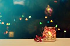 Christmas Festive Decoration. Christmas Candle  on Festive Bokeh Background Stock Photos