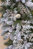 Christmas festive decorations with pine twig, baubles, artificial snow Stock Photos