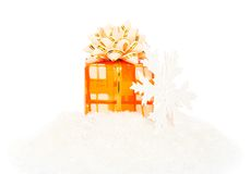 Christmas festive gift and snowflakes on snow Royalty Free Stock Images