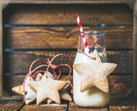 Christmas festive gingerbread star shaped cookies and bottle with milk Royalty Free Stock Images