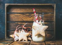 Christmas festive gingerbread star shaped cookies and bottle with milk Stock Photos