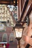Christmas lantern. Festive illumination on a wooden house. Christmas Festive illumination lantern on a building. Lights background. Festive illumination on a royalty free stock images