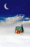 Christmas festive light in house under sky. Christmas festive light in house under blue sky Stock Photo