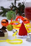 Christmas, festive mood: glass of champagne and New Year`s decoration. Focus selective.  Stock Photo
