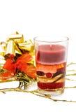 Christmas festive red candle. Celebrating Christmas with festive red candle and golden decorations. Isolated on white Royalty Free Stock Photo