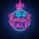 Christmas festive sale of a poster in a neon style. Vector discount card, neon sign, bright banner, luminous sign, neon. Night advertising, Xmas discount sale Stock Images