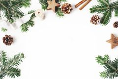 Christmas festive styled stock composition. Decorative floral frame. Fir tree branches border. Pine cones, wooden stars royalty free stock photos