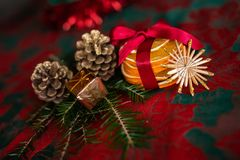 Christmas festive table ornament with dried orange. And red bow stock image