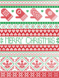 Christmas and festive winter seamless pattern in cross stitch with mittens ,heart, angel,  ornaments in red, green. Merry Christmas Tall Scandinavian Printed Stock Images