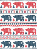 Christmas and festive winter seamless pattern in cross stitch style with polar bear,  snowflake, star, heart,. Scandinavian style and Nordic culture inspired Stock Photo