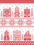 Christmas and festive winter village pattern in cross stitch style with gingerbread house, church, little town buildings, trees. Scandinavian style and Nordic Stock Photos