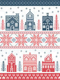Christmas and festive winter village pattern in cross stitch style with gingerbread house, church, little town buildings, trees. Scandinavian style and Nordic Stock Photo