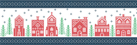 Christmas, festive winter wonderland village pattern in cross stitch style with gingerbread house, church, little town house Royalty Free Stock Image