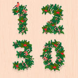 Christmas festive wreath numbers: 1, 2, 3, 0. Wooden background Royalty Free Stock Images
