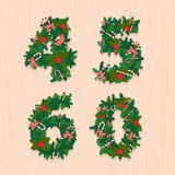 Christmas festive wreath numbers: 4, 5, 6, 0. Wooden background Stock Photos