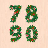 Christmas festive wreath numbers: 7, 8, 9, 0. Wooden background Stock Image