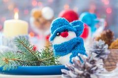 Christmas festive xmas eve table board setting New Year snowman Stock Photo