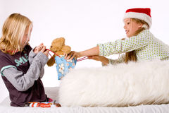 Christmas fight. Two children having a fight about the present stock image