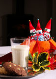 Christmas Figures with Milk Glass and Cookies On Tin Plate Royalty Free Stock Photos