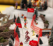 Christmas figures skiing down a slope Royalty Free Stock Photos