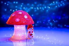 Christmas Figures. Snowman Under A Big Mushroom. Stock Photos