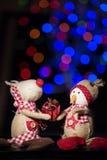 Christmas figurines. Christmas figurine toys on colorful bokeh background Stock Photography
