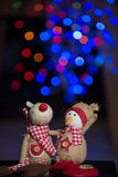 Christmas figurines. Christmas figurine toys on colorful bokeh background Royalty Free Stock Image