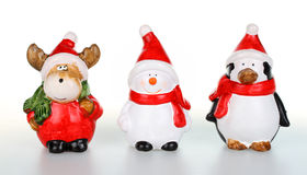 Christmas figurines. Reindeer,snowman and penguin Royalty Free Stock Photo
