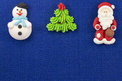 Christmas figurines sweet mastic on a blue background Royalty Free Stock Images