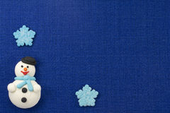 Christmas figurines sweet mastic on a blue background Stock Image