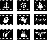 Christmas film. Set of six film negative style buttons containing Christmas icons Stock Images