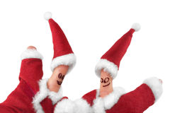 Christmas fingers show-1. Fingers dressed in Santa-Claus red-white costumes Royalty Free Stock Image