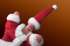 Christmas fingers show-2. Fingers dressed in Santa-Claus red-white costumes Stock Photography