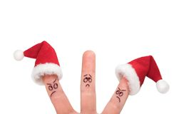 Christmas fingers show-5. Fingers dressed in Santa-Claus red-white hats Royalty Free Stock Images