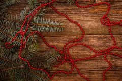 Christmas. Fir with beads on the table Stock Photography