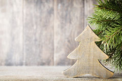 Christmas fir branch and decor, on the wooden background. Stock Photos