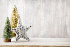 Christmas fir branch and decor, on the wooden background. Royalty Free Stock Images